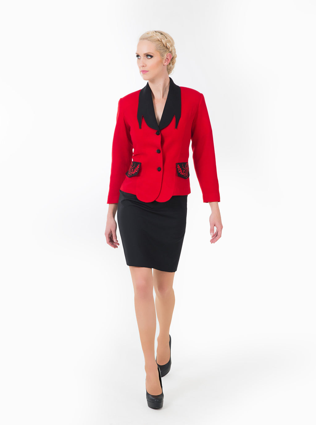 Women's red business suit. Glamorous look for business or everyday.  Front of dress shows unique black color and embroidery.