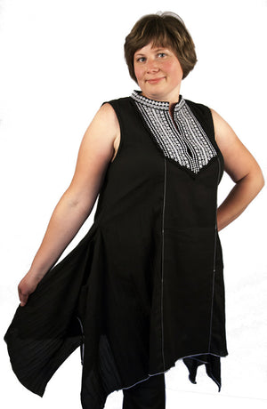 Zelenco's sleeveless black dress with white and black embroidered patterns highlighting the top and collar. The look and feel of lace is enhanced with a flaring lower pattern.
