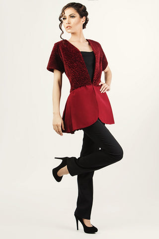 Zelenco's burgundy lambskin jacket with blank pants and strapless top.