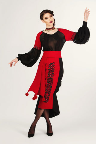 The wool outfit comes with an embroidered red and black see through blouse with puffed sleeves, a long black wool dress, and Zelenco's unique wide red belt.