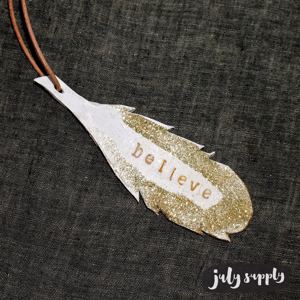 gold ceramic feather ornament : believe