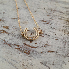 Gold horseshoe cubic zirconia
