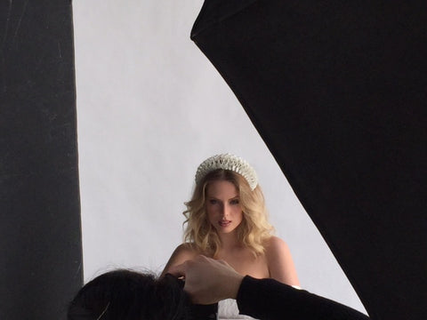 Jenny Guttridge being photographed in The Season Hats bridal hairband