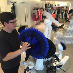 Paul Stafford demonstrating The Season's unfolding hats for Royal Ascot