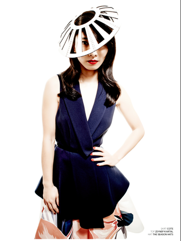 Actress Jing Lusi in The Season Hats leather disc headpiece