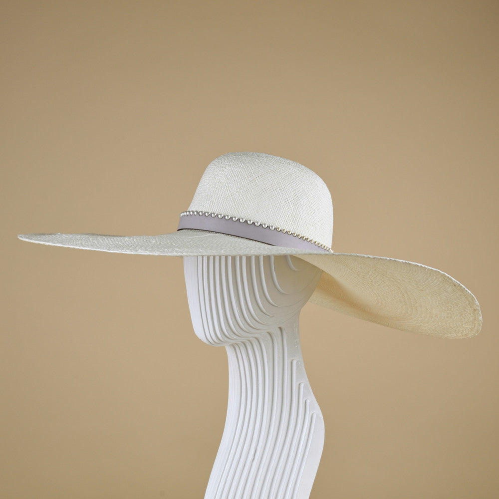 Wide brim sun hat trimmed with leather and Swarovski pearls