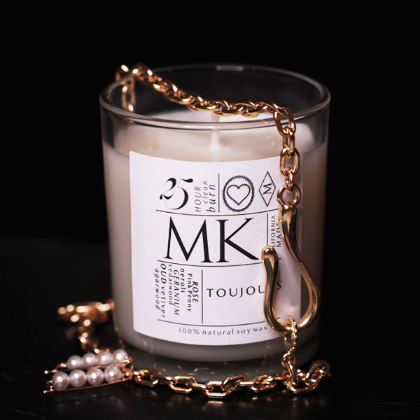 candle with hook necklace and pearl earrings