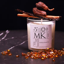 Load image into Gallery viewer, small candle with amber, vanilla, sandalwood and cardamom pods on black marble