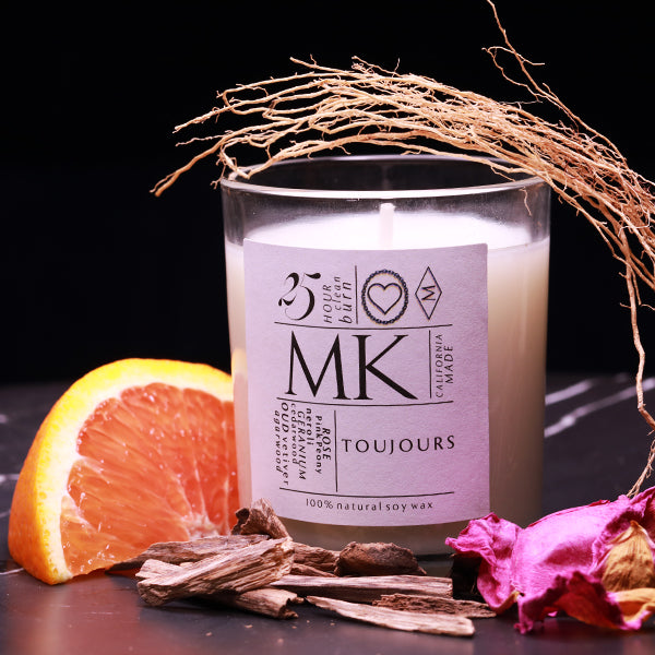 candle with orange, wood and roses