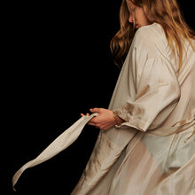 Load image into Gallery viewer, Girl with Blonde hair wearing Cream Silk Kimono Robe looking down holding the belt