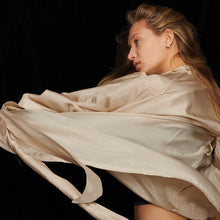 Load image into Gallery viewer, Girl with Blonde hair wearing cream silk kimono robe with robe floating in the air