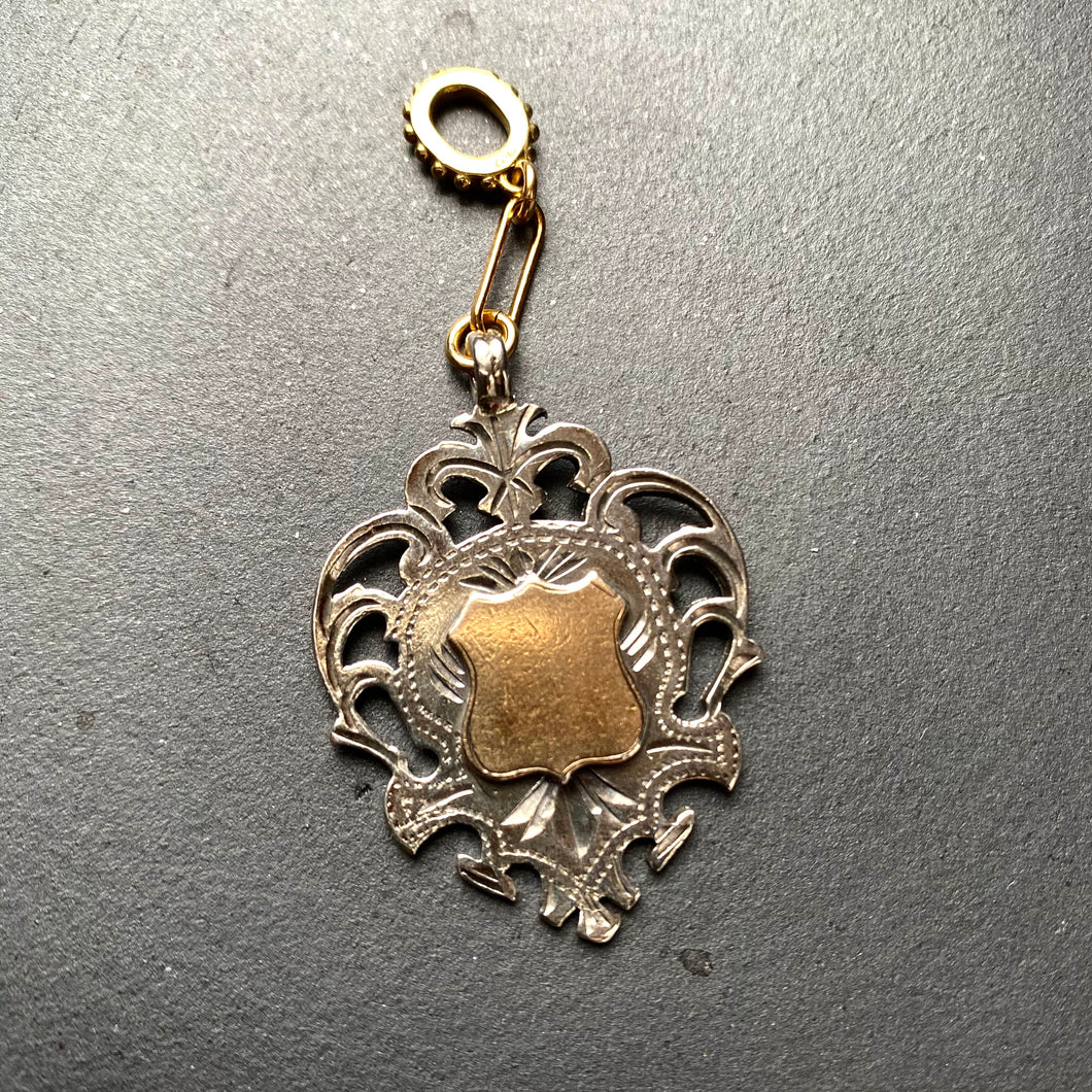 Antique Sterling Shield Charm XXVIII