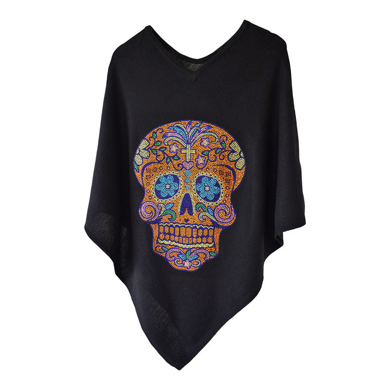 Black cashmere poncho featuring large, sparkling sugar skull crystal embellishment. By Cashmere Rebel London.