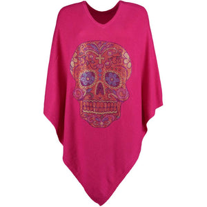 Pink cashmere poncho featuring large, sparkling sugar skull crystal embellishment. By Cashmere Rebel London.