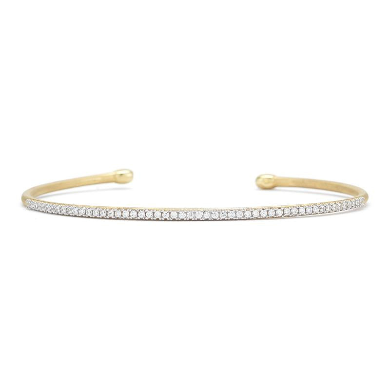 14KY BRUSHED-SATIN FINISHED TUBE BANGLE BRACELET, SET WITH 0.40 CARAT DIAMONDS.