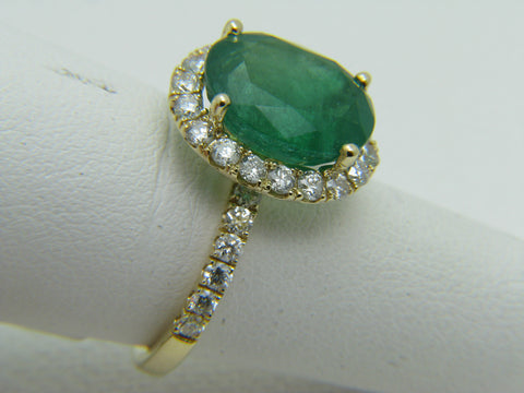 Lady's 14K 5.25 ct Oval Emerald Ring with 1.00 ctw Round Diamond Halo
