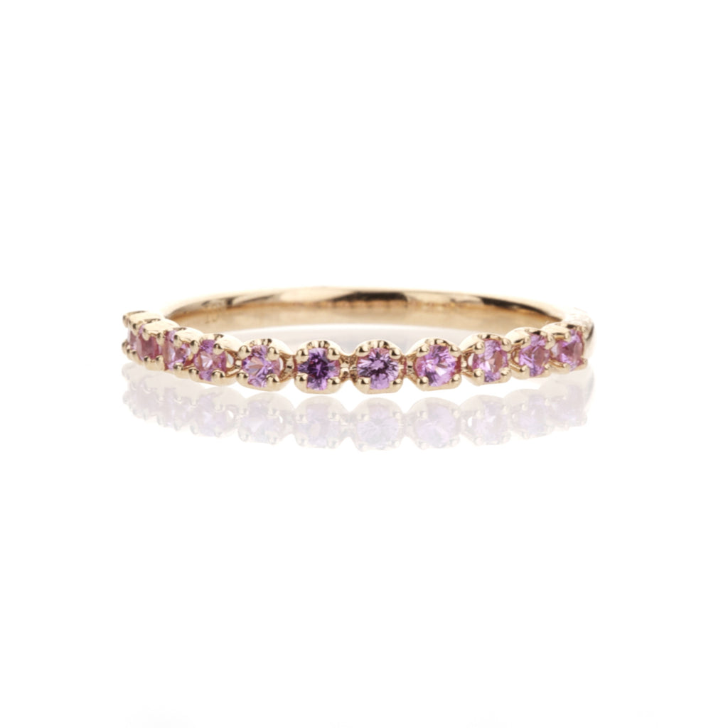 0.30ct pink sapphire band set in warm 14K rose gold
