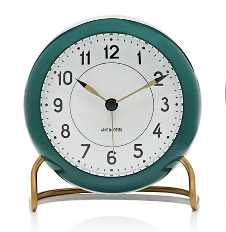 Pretty green analog alarm clock with a white face and a green body on a brass-toned stand.