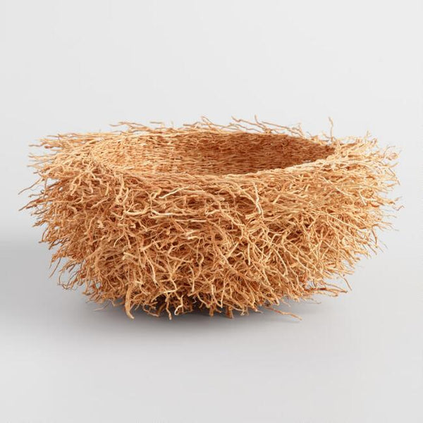 A handwoven basket composed of vetiver grass from Madagascar. Looks like a bird's nest.