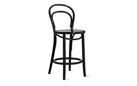 Tall, black reproduction of a Thonet counter stool with a curved back, on white background.
