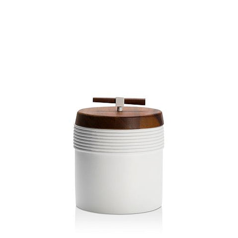 A white porcelain jar with an acacia-wood lid designed to hold bath crystals.