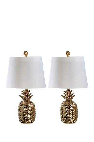 Pair of gold ceramic pineapple lamps with white shades.