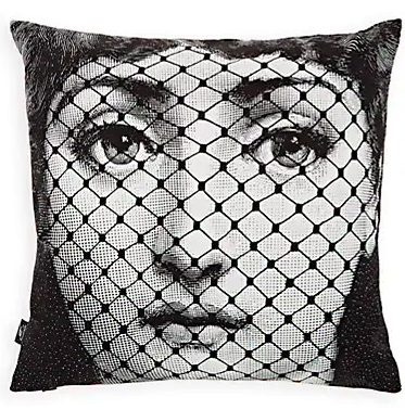 The reverse of the Fornasetti Burlesque throw pillow featuring a black and white image of a woman with fishnet covering her face.