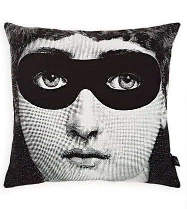 Throw pillow featuring iconic Fornasetti burlesque image of woman with a black mask over her eyes.