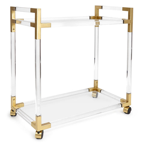 An acrylic bar cart with straight lines and brass details shot on a white background.