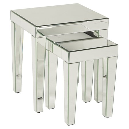 A set of three mirrored nesting tables on a white background.