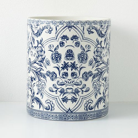 A traditional porcelain blue and white waste basket shot on a white background.