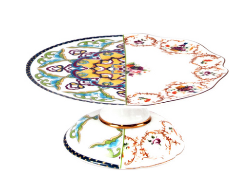 A bone china cake plate with two separate, but traditional, motifs. Looks like a cake plate made of two different items. Seletti.
