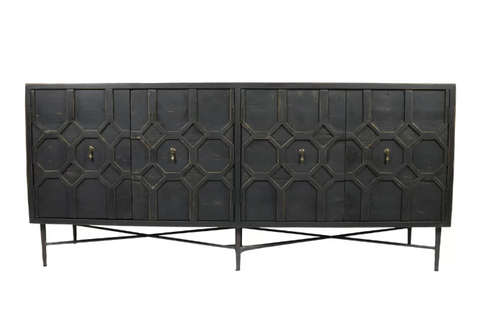 A large black solid pine credenza with 4 doors and a carved trellis pattern on the front.