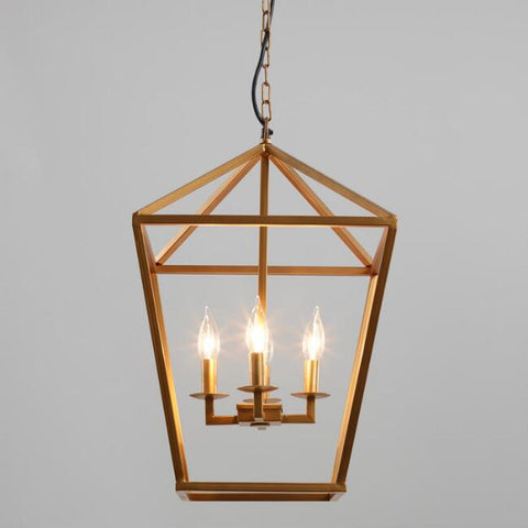A pendant lamp modeled after a turn of the century gaslight. Shot on a gray background.