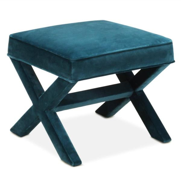 A teal blue upholstered x bench on a white background.