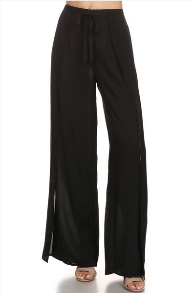 Solid, high waisted, full length pants with a waist tie in a straight leg style.
