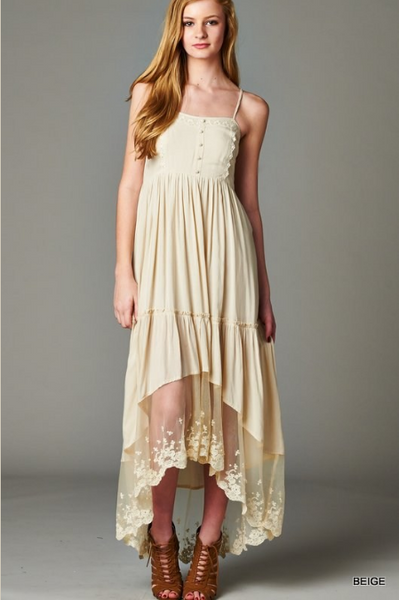 Spaghetti strap, maxi dress featuring edge lace around bottom hem and lace trim on upper half.
