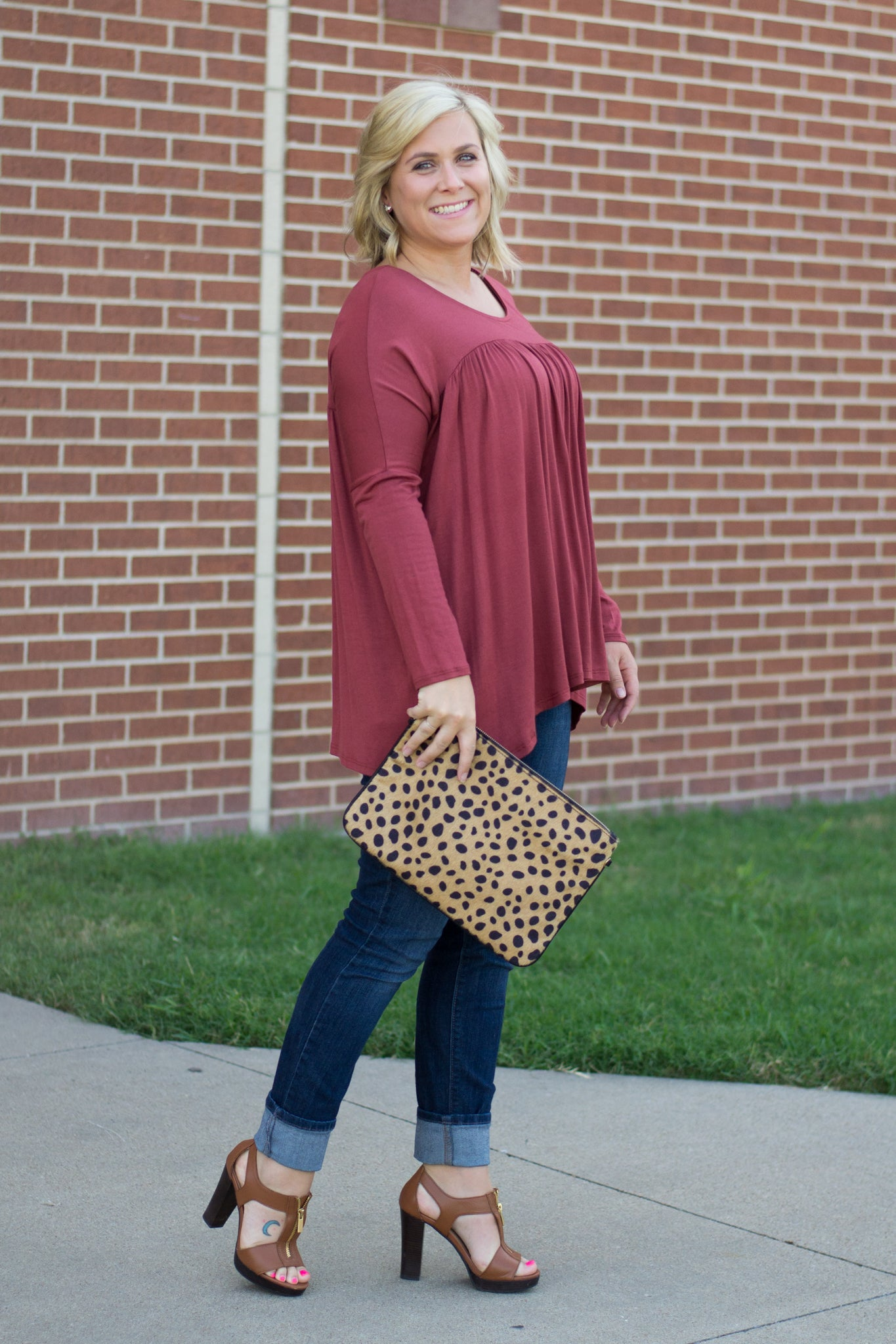 Pink Babydoll Top paired with Skinny Jeans and Leopard Clutch
