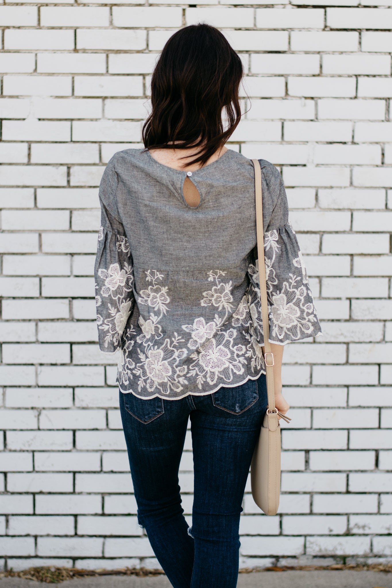 White floral embroidered top with peep hole back