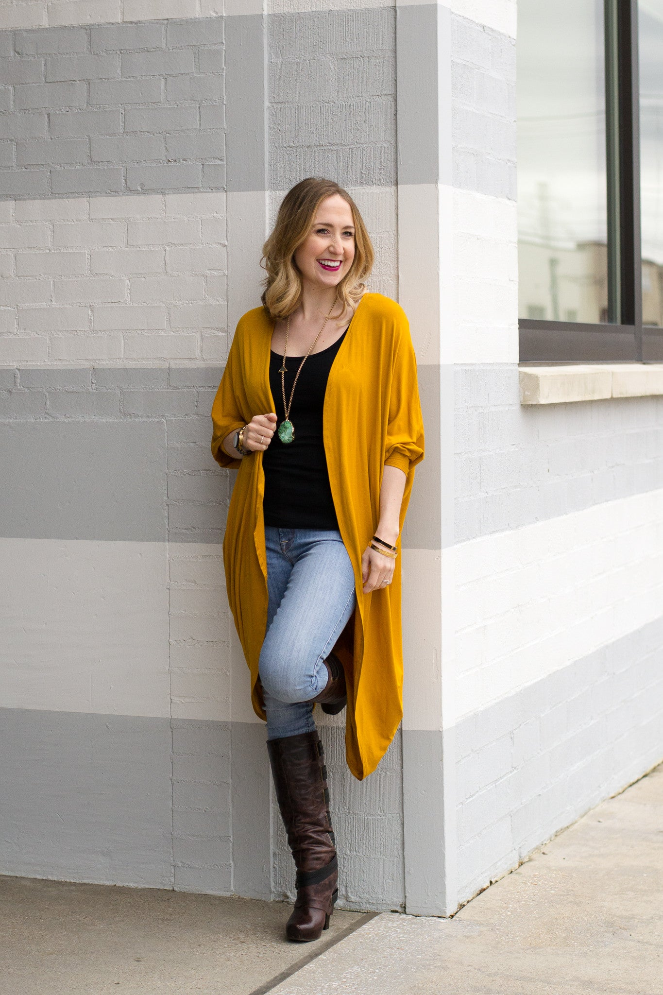 Mustard Cocoon Cardigan paired with tall boots