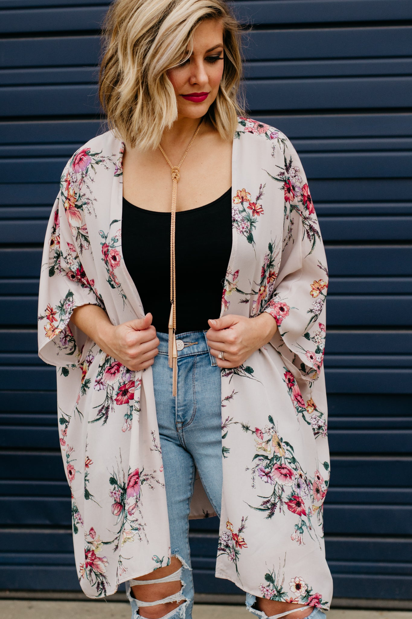 Mauve and floral kimono with gold tassel necklace