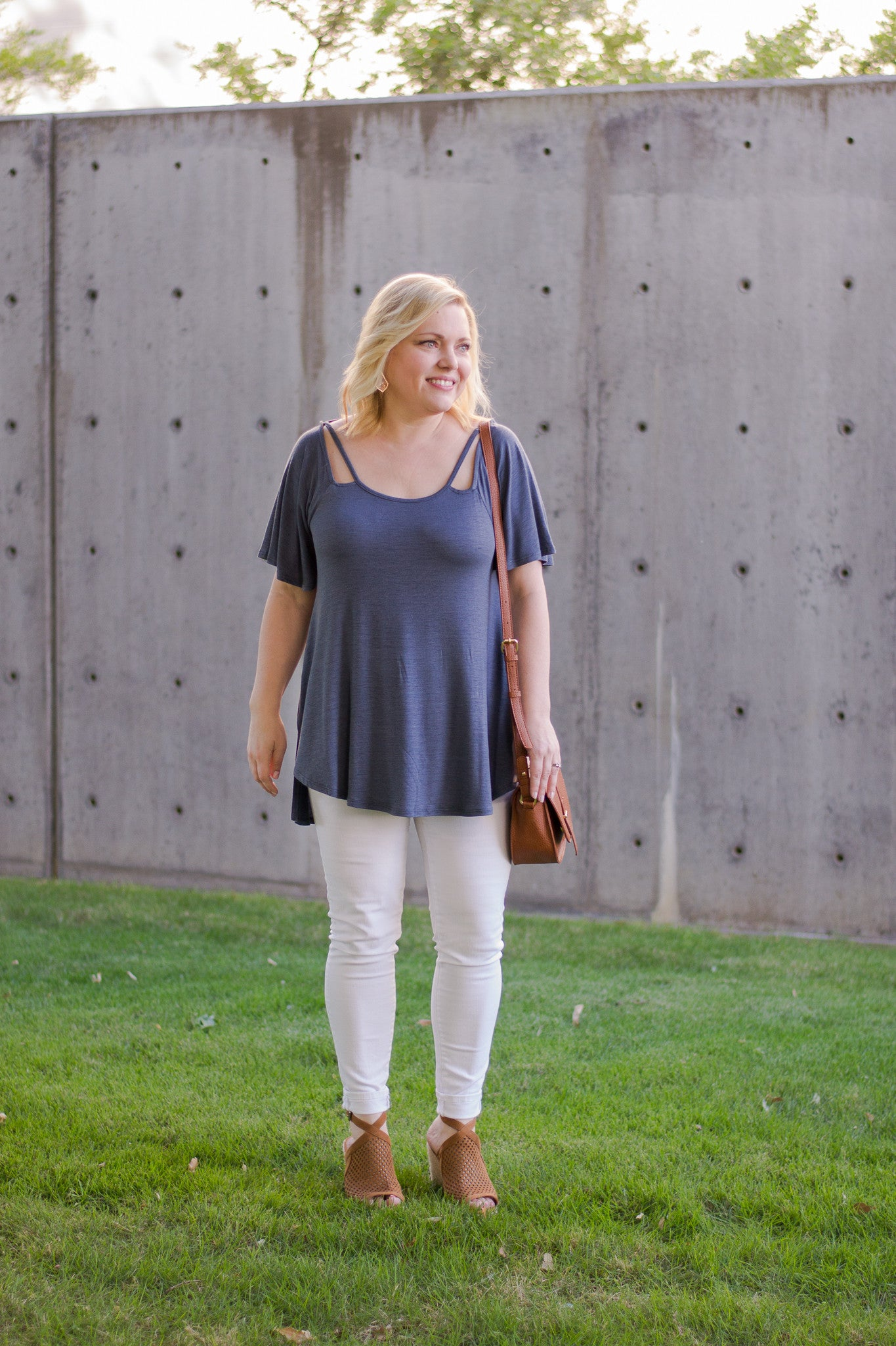 Basic Top with neckline cutouts paired with white jeans and wedges