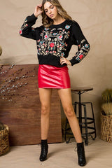 Multi color embroidered long sleeve french terry knit top.