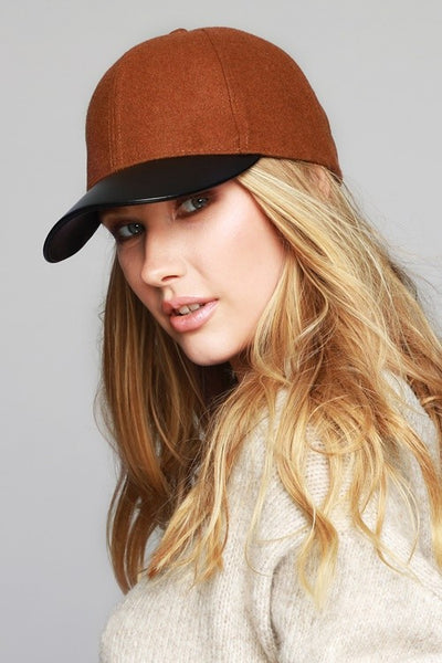Faux leather accented brim baseball cap
