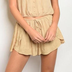 Tan cute shorts.