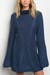 Long sleeve cable knit sweater dress that features a cowl neckline.