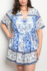 Plus size short sleeve scoop neck printed tunic dress.
