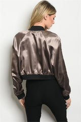 Long sleeve studded cropped moto jacket.