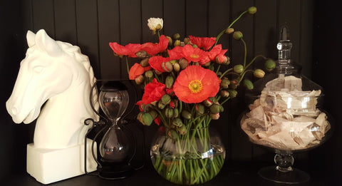 Statues, vases of flowers and apothocary jars