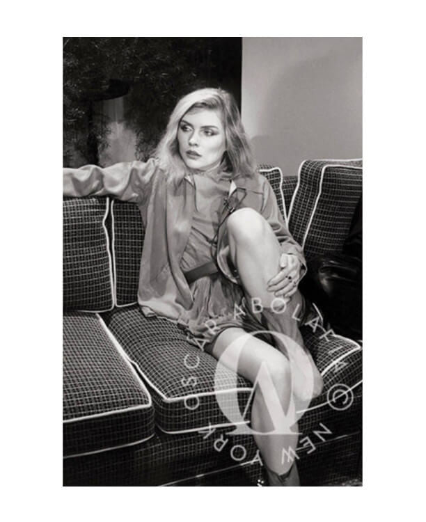 Oscar Abolafia - Debbie Harry of 'Blondie' on couch in the Green Room. New York City ca. 1987.